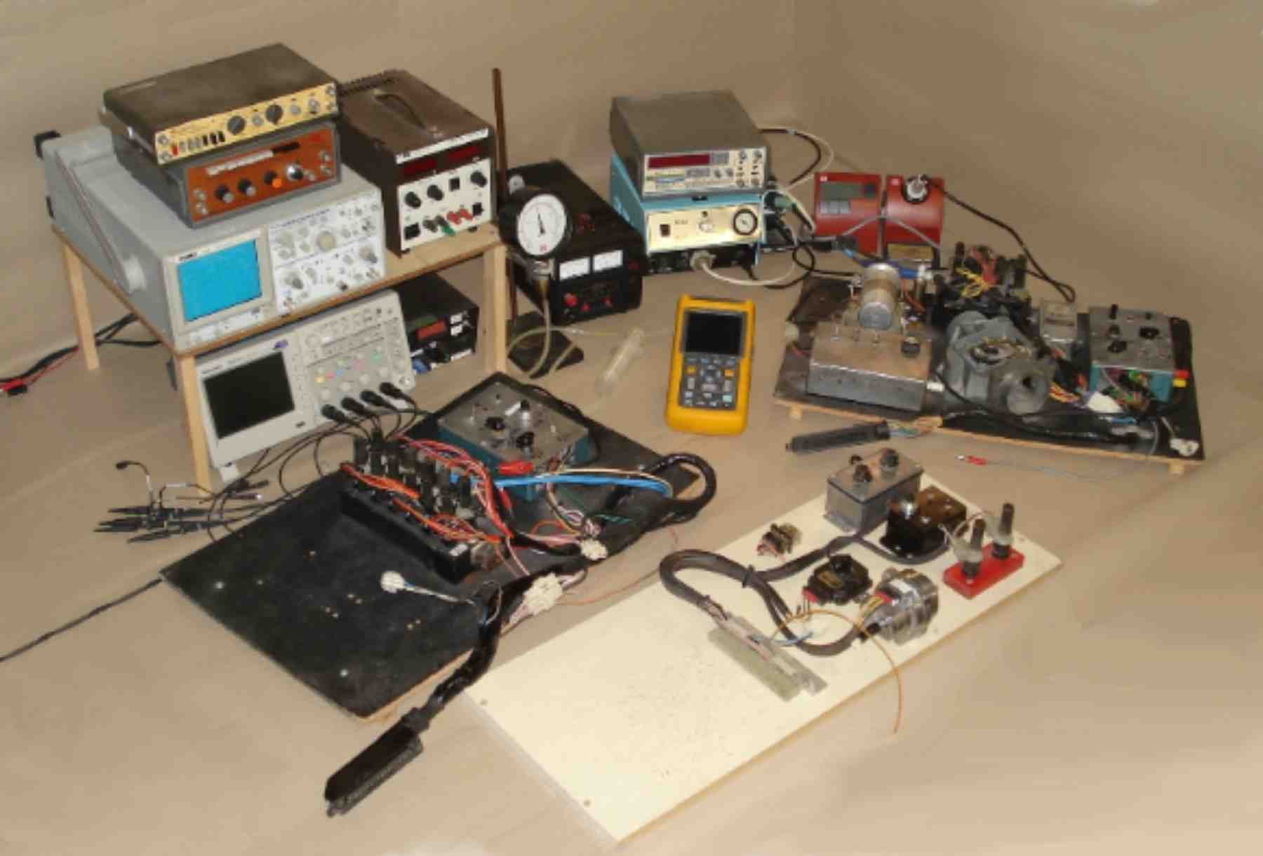 Fig. 15. Test boards, instrumentation and equipment for ECU testing, repairs and upgrades.
